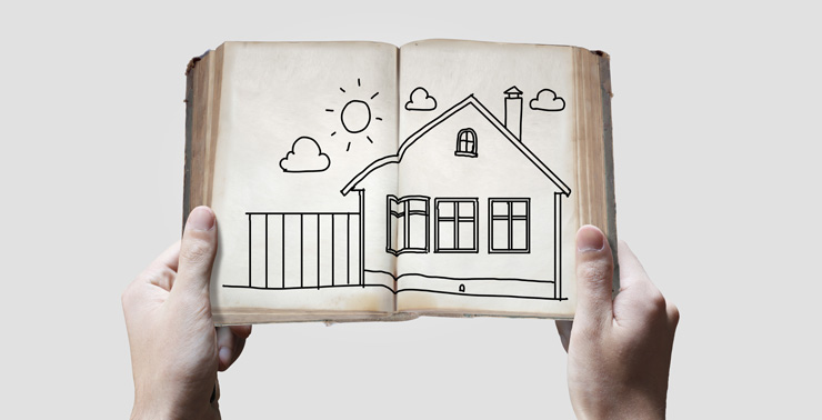 hands-holding-sketch-book-of-house