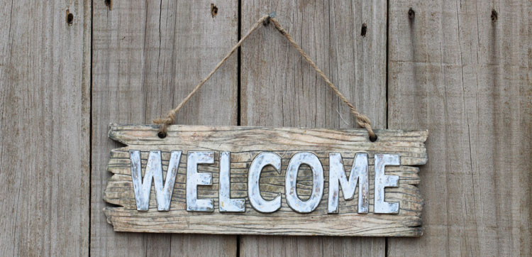 rustic wooden welcome sign hanging with nail